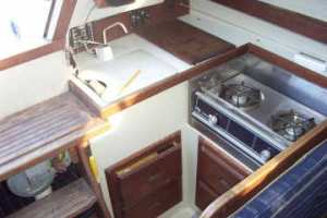 Catalina 25 Galley with Dinette Interior, Swing Keel Winch Below Companionway, Fuse Panel Behind Sink
