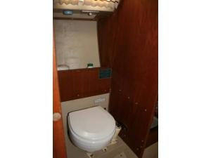 Catalina 25 Head with Marine Toilet, Storage Behind