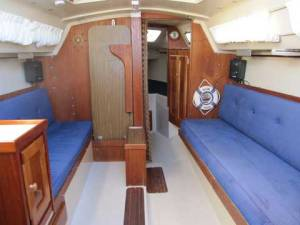 Catalina 25 with Traditional Interior, Table Raised, Showing Swing Keel Trunk