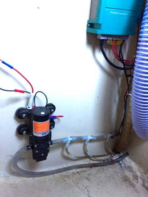 The suction manifold, discharge tube, and diaphragm pump